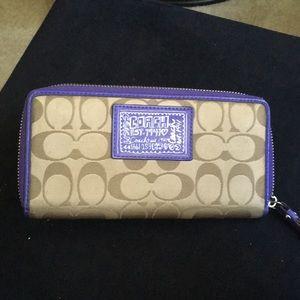 Coach accordion zip wallet in purple